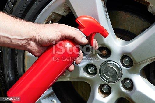 istock Hand applying polish car wheel 493087744