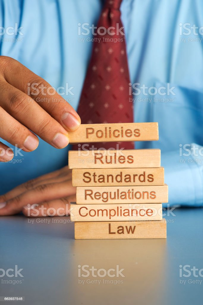 Hand arranging wood block concept of Policies stock photo