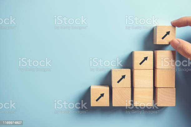 Hand Arranging Wood Block Stacking As Step Stair On Paper Pink Background Business Concept Growth Success Process Copy Space - Fotografias de stock e mais imagens de Adulto