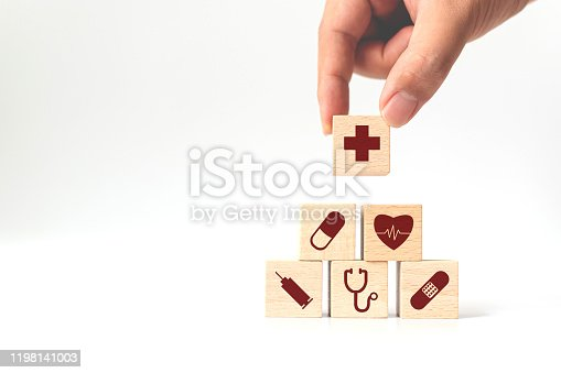 1029077176istockphoto Hand arranging wood block stacking with icon healthcare medical, Insurance for your health concept 1198141003