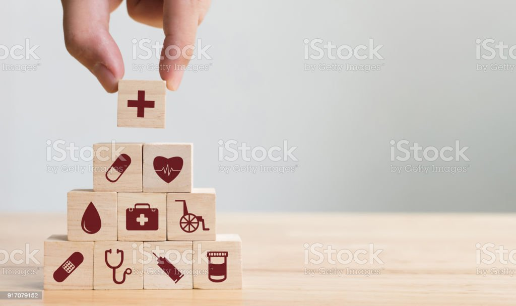 Hand arranging wood block stacking with icon healthcare medical, Insurance for your health concept - Foto stock royalty-free di A forma di blocco