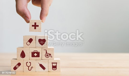917079152istockphoto Hand arranging wood block stacking with icon healthcare medical, Insurance for your health concept 917079152