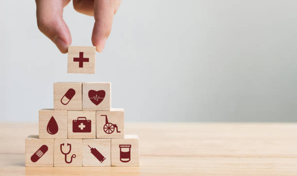 hand arranging wood block stacking with icon healthcare medical, insurance for your health concept - healthcare and medicine stock pictures, royalty-free photos & images