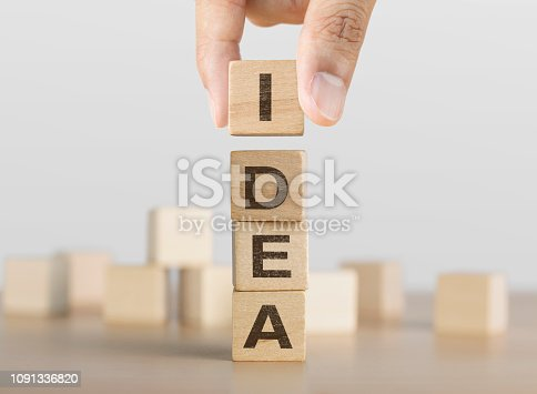 istock Hand arranging wooden blocks with the word IDEA. Idea, Creative, solution or problem solving concept. 1091336820