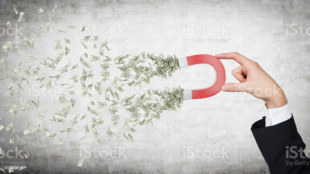 hand attracts money stock photo