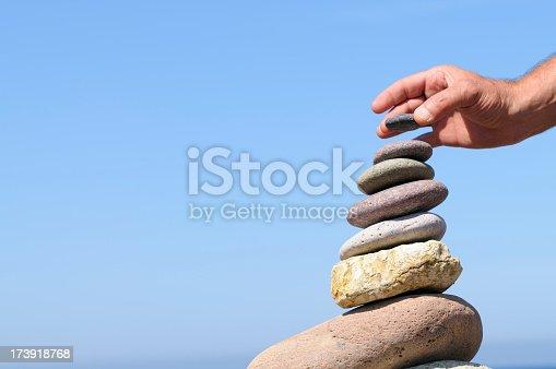 591835714 istock photo Hand  Balancing Stones 173918768