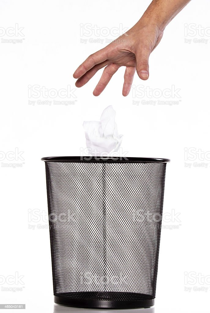 Hand battered card ejection in the trash stock photo