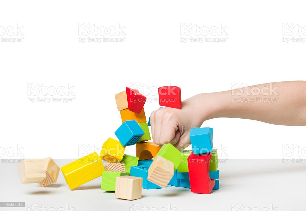Hand beating house made of color wooden blocks stock photo