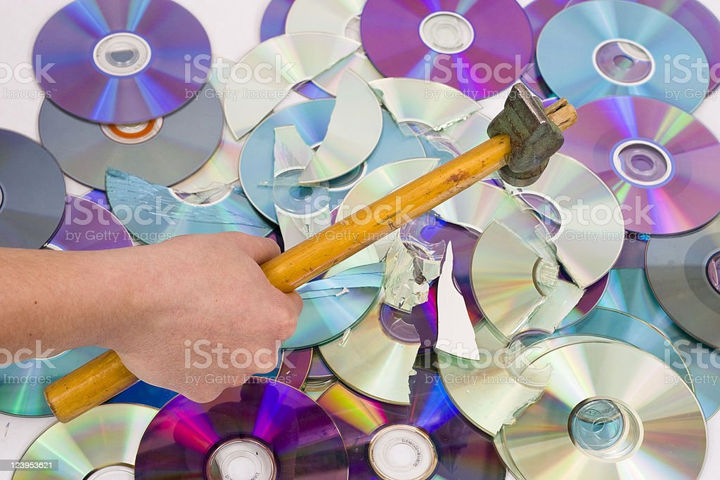 Hand beating out cd stock photo