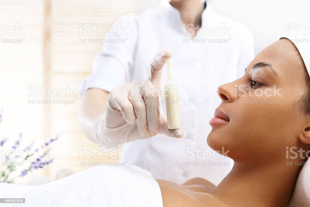 Hand Beauticians Shows An Ampoule With A Cosmetic