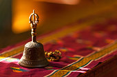 Ritual hand bell in the Buddhist temple as the enlightenment symbol, has got to a light beam.