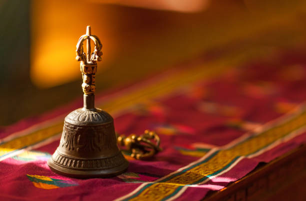 hand bell, in sunlight inside a temple - bell stock pictures, royalty-free photos & images