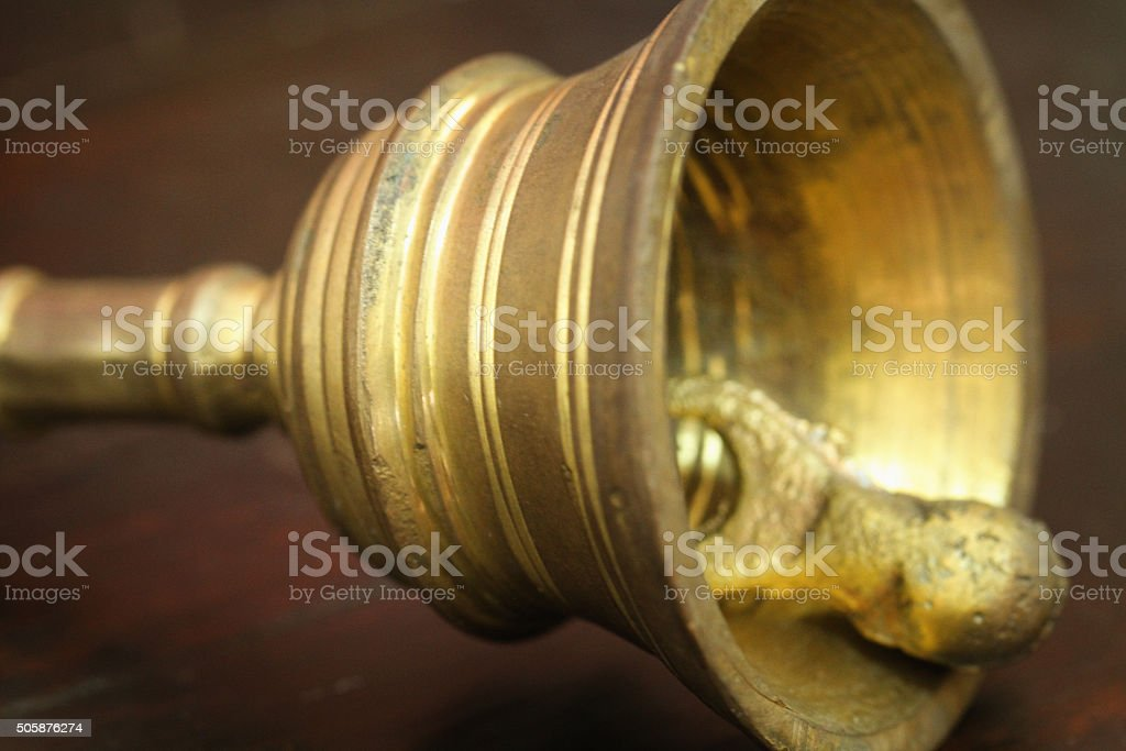 Hand bell on brown wood table stock photo