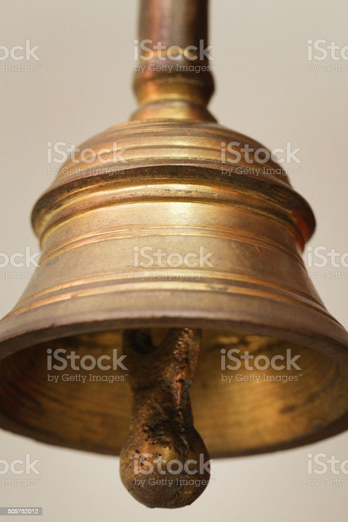 Hand bell on grey background stock photo