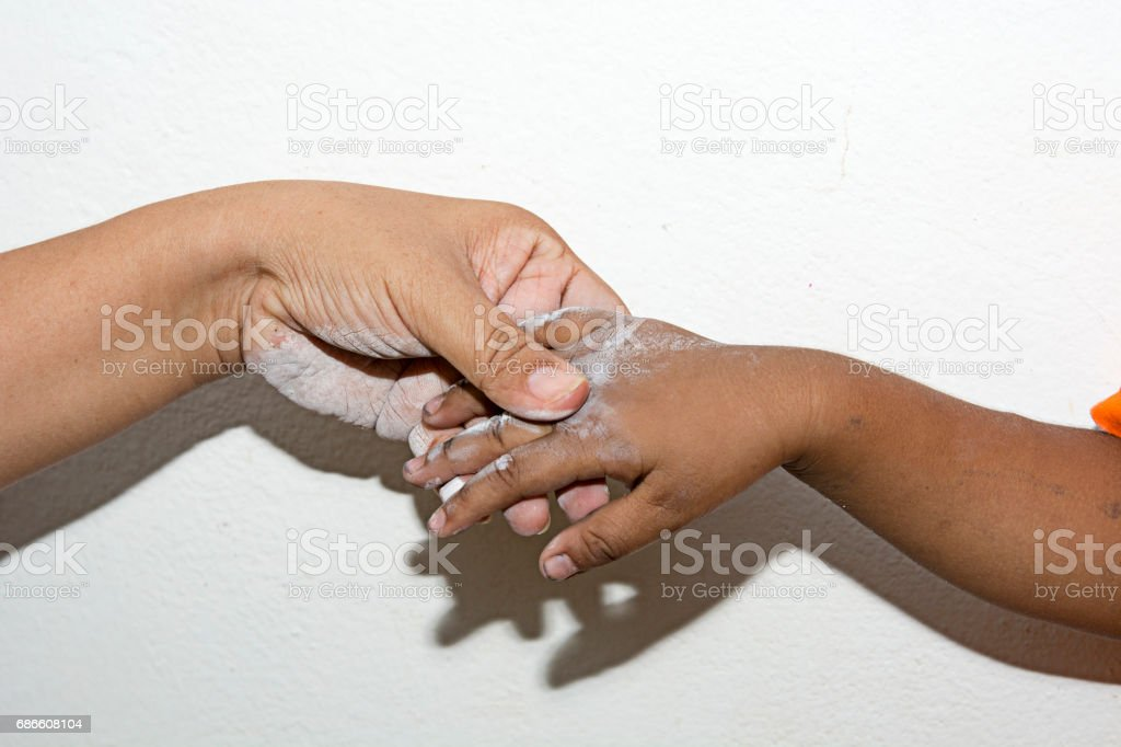 Hand Big and small on concrete wall.Crevice on the wall royalty-free stock photo