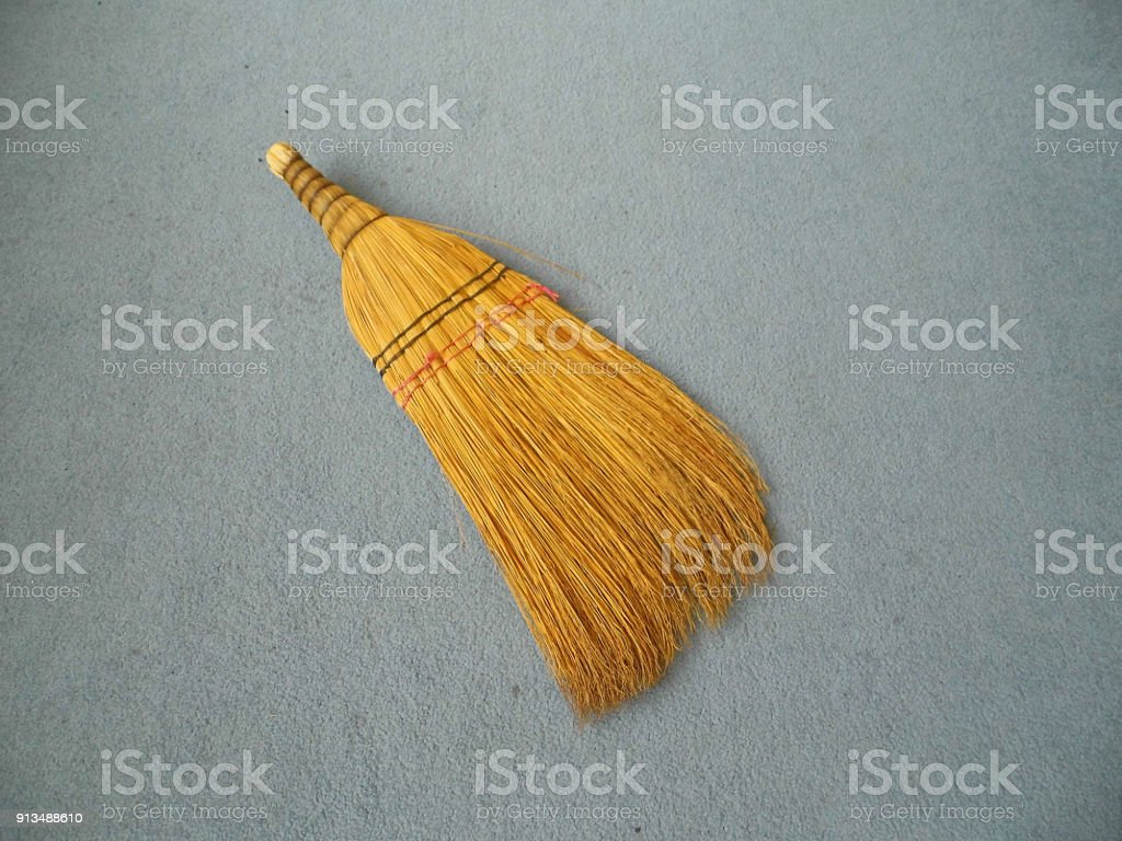 hand broom, broom made of plant roots, classical house broom, stock photo