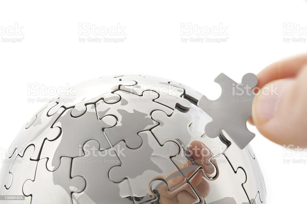 hand building puzzle globe on white royalty-free stock photo