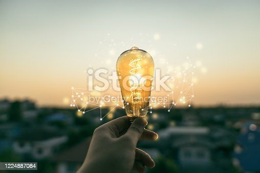 Hand business man holding light bulb with light line. Alternative energy, idea, saving electricity innovation and inspiration concepts.