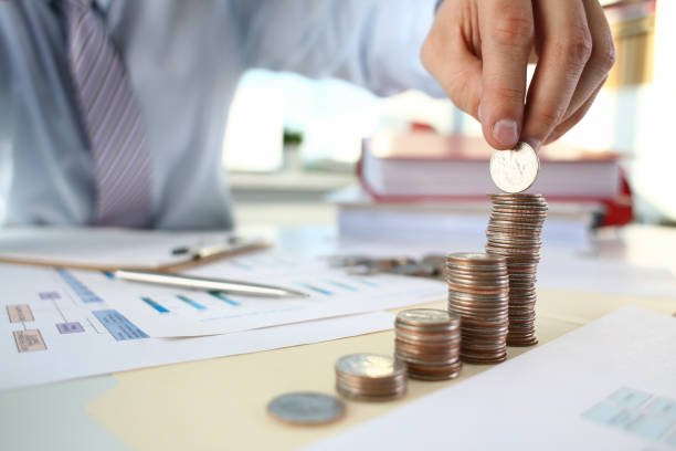 hand businessman putting pin money - wildlife reserve stock pictures, royalty-free photos & images