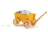 hand cart full of Dollar notes. This notes are miniatures, made by myself. More money? In my portfolio.