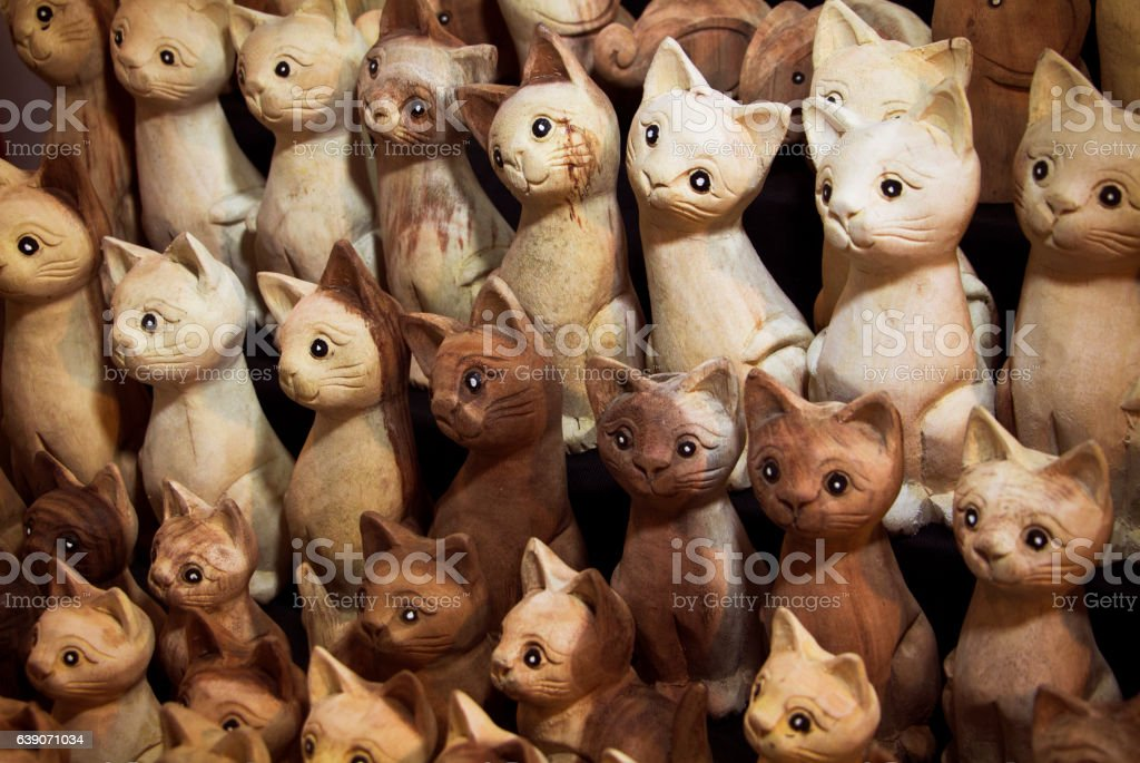 hand carved wooden cat statues stock photo