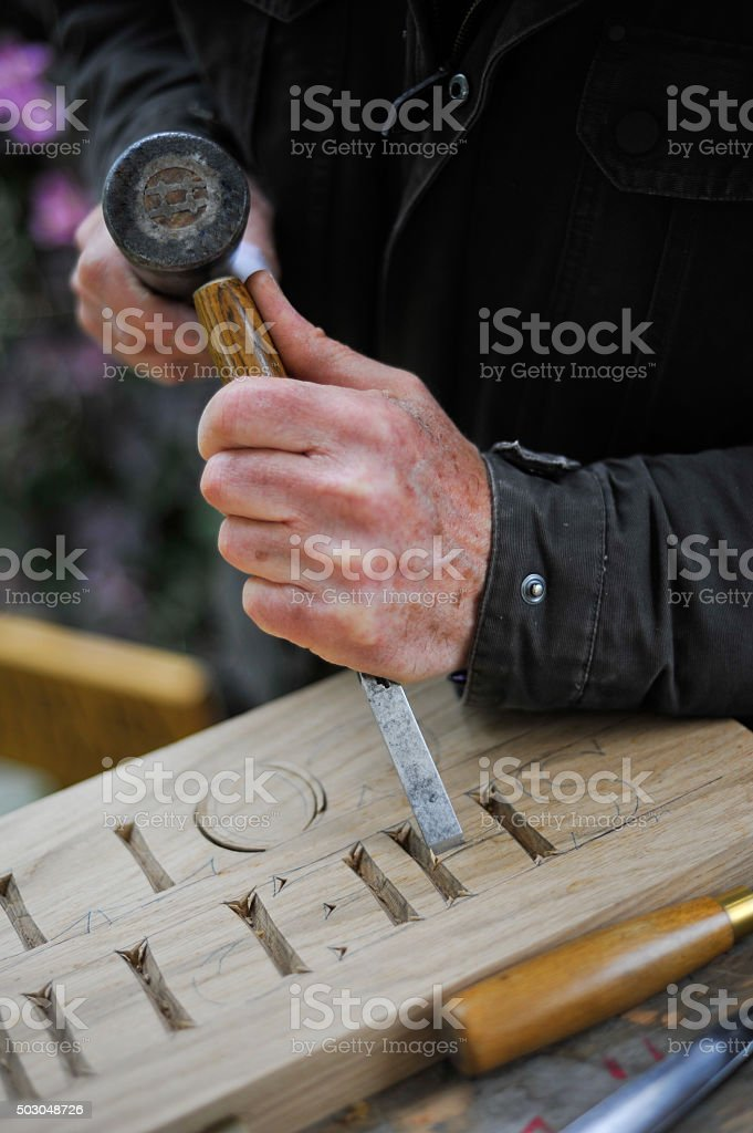 Hand carving stock photo