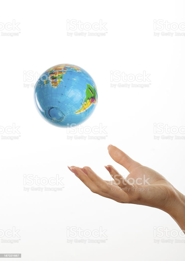 Hand cast up globe earth on white royalty-free stock photo