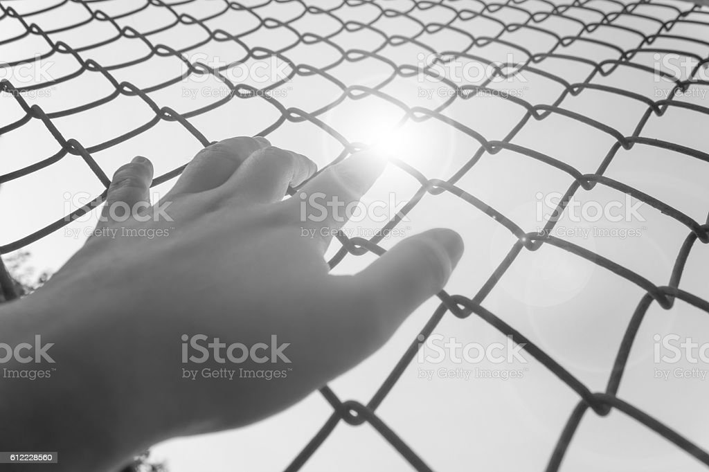 Hand catching iron bar,freedom desire concept stock photo
