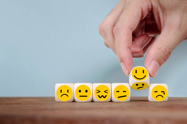 Hand Changing with smile emoticon icons face on Wooden Cube, hand flipping unhappy turning to happy symbol Hand Changing with smile emoticon icons  face on Wooden Cube , hand flipping unhappy turning to happy symbol negative emotion stock pictures, royalty-free photos & images