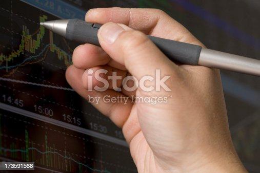 studio shot of hand charting graph