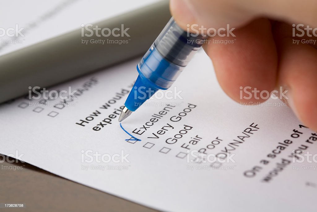 A hand checking off an excellent box royalty-free stock photo