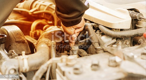 istock Hand checking on car radiator of overheating 1095381544