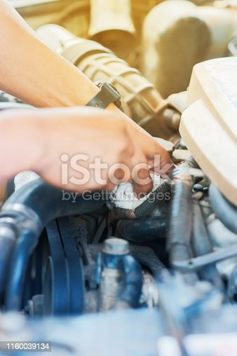 istock Hand checking on car radiator of overheating 1160039134