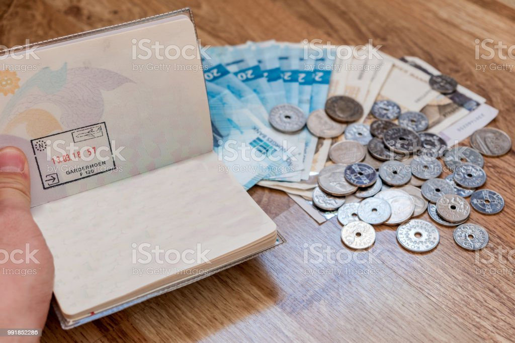 Hand Checking Passport With Currency Coins Cash Of Nok Royalty Free Stock Photo