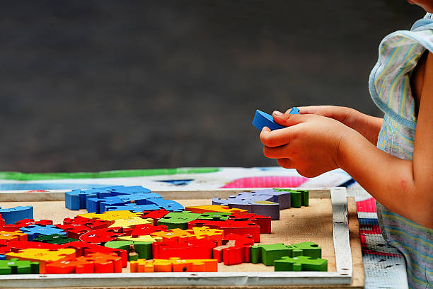 Hand child playing with construction blocks stock photo