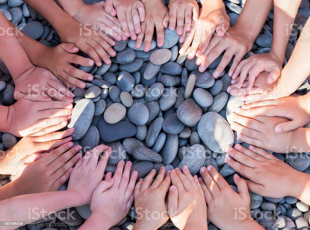 Hand children shape circle on the beach. Lizenzfreies stock-foto
