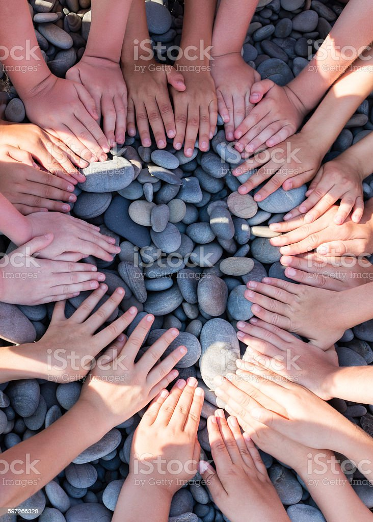 Hand children shape circle on the beach. royalty-free stock photo