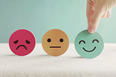 istock Hand choosing green happy smiley face paper cut, product, user, service feedback rating and customer reveiw, experience, satisfaction survey, psychology mental health test concept 1227064104
