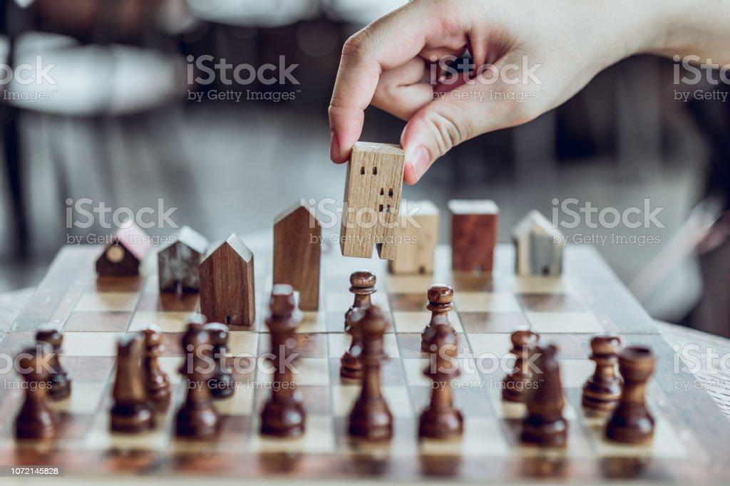 Hand Choosing Mini Wood House Model From Chess Game Choose