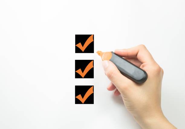 Hand choosing three of options stock photo