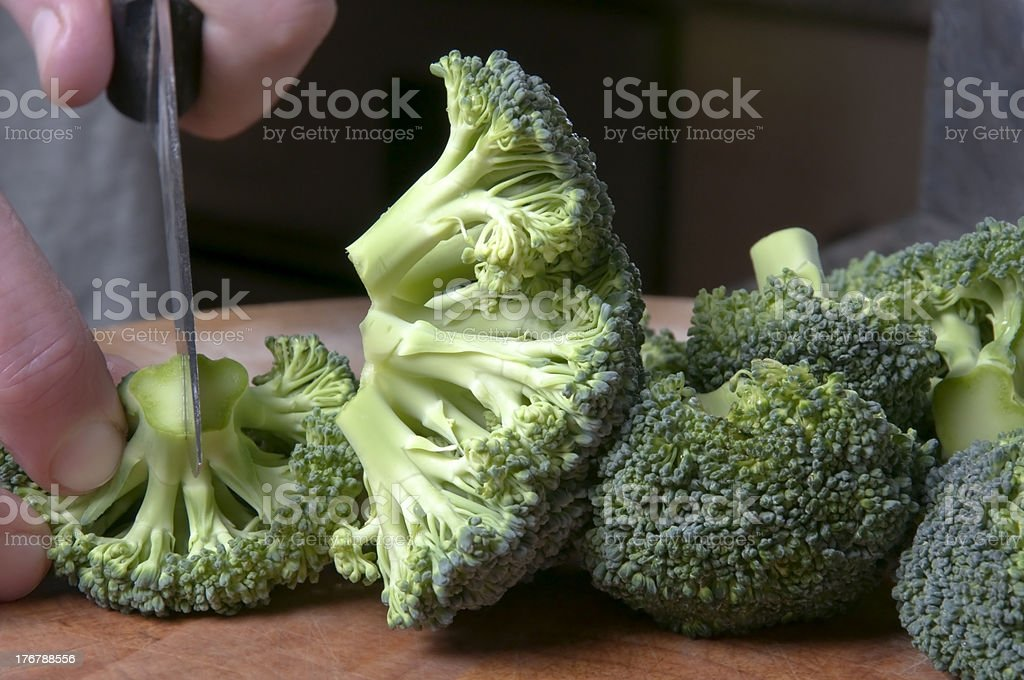Hand Chopping Broccoli royalty-free stock photo
