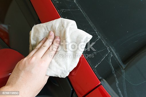 istock Hand cleaning car with towel. 626619850