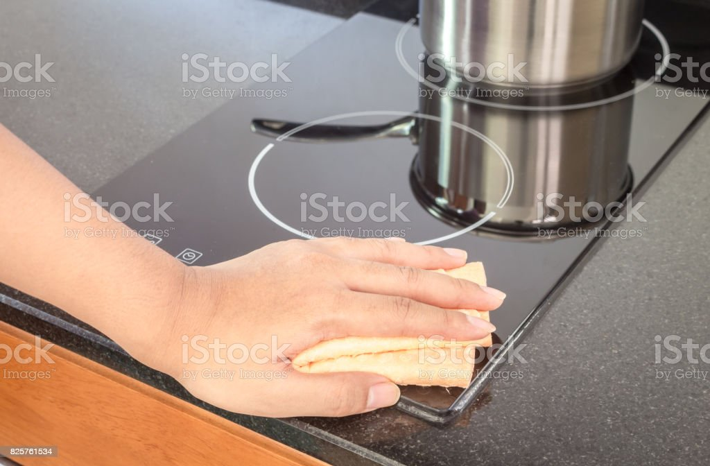Hand cleaning cooker at home kitchen stock photo