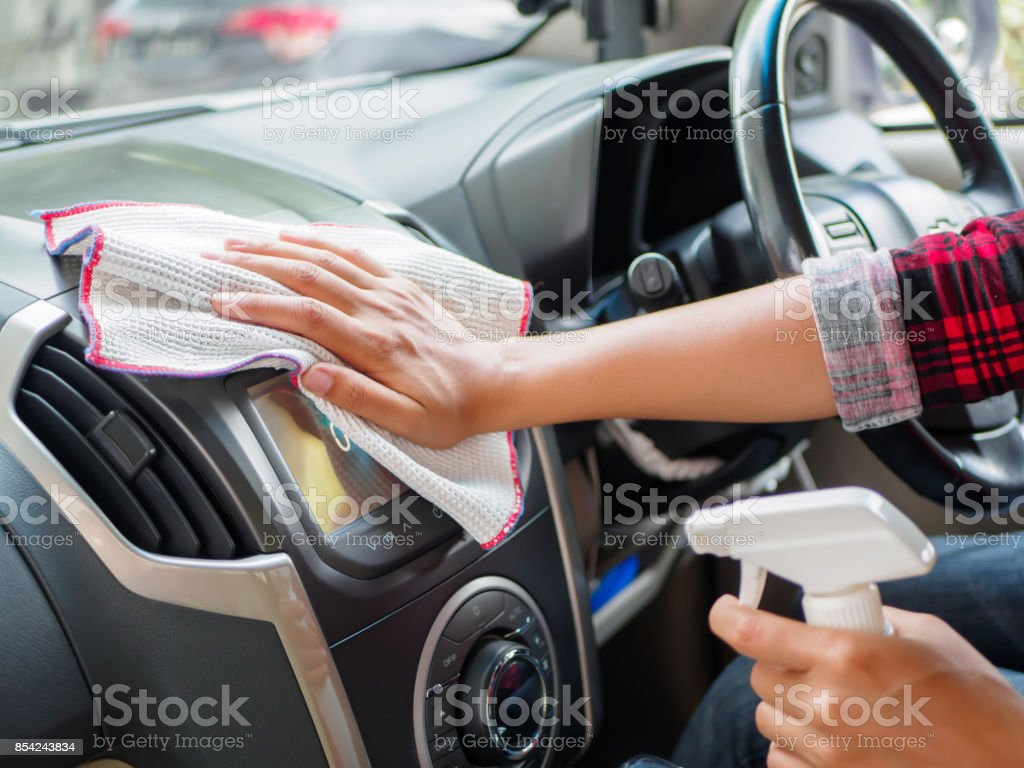 Hand cleaning interior car with microfiber cloth stock photo