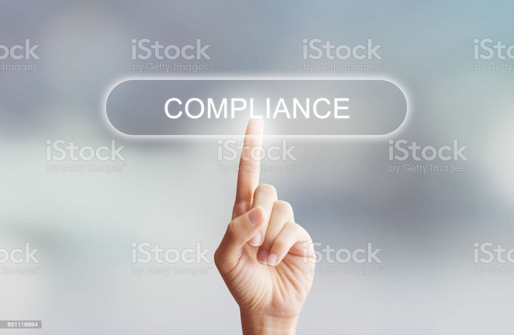 hand clicking compliance button stock photo