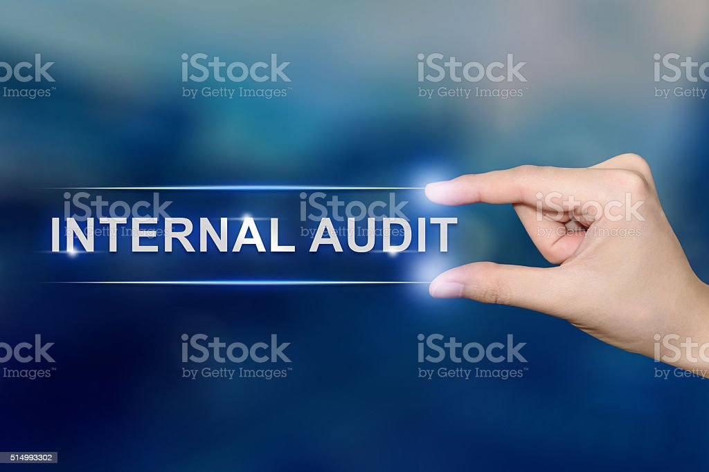 hand clicking internal audit button stock photo
