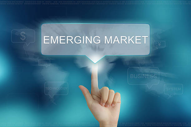 hand clicking on emerging market button stock photo