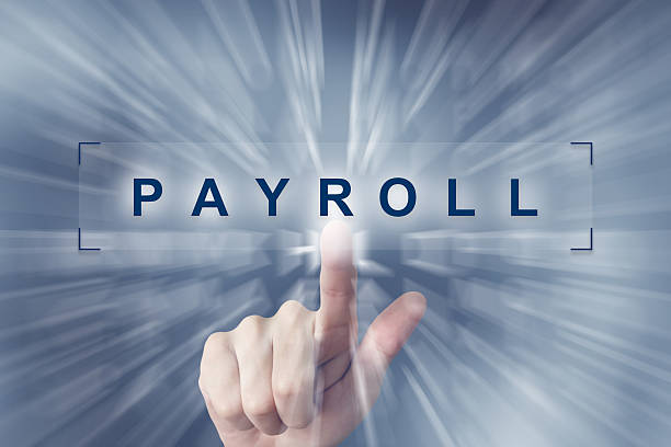 hand clicking on financial payroll button stock photo