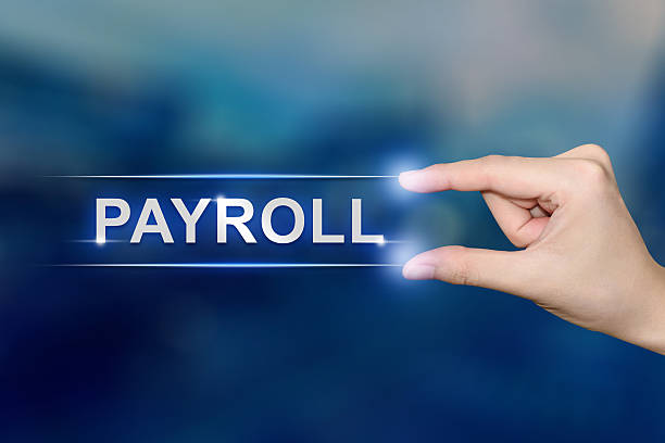 hand clicking payroll button stock photo