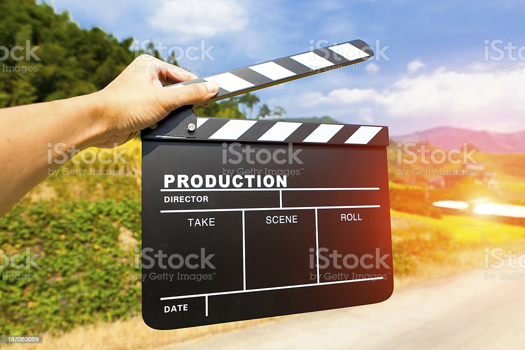 Hand closeup holding clapper board stock photo